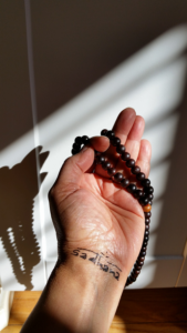 Mala beads reflect knotted cords like the Druid Cord